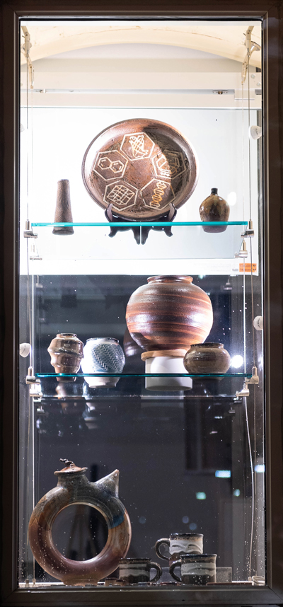 Pottery pieces created by NC State student Jake Goodnight, displayed in a gallery window.